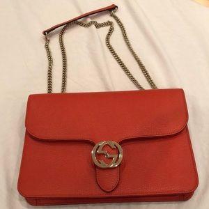 Orange Gucci purse